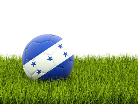 Football with flag of honduras on green grass photo
