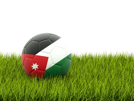 Football with flag of jordan on green grass photo
