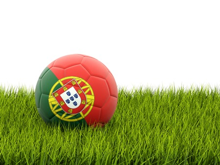 Football with flag of portugal on green grass photo