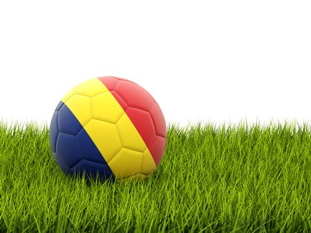 Football with flag of romania on green grass photo