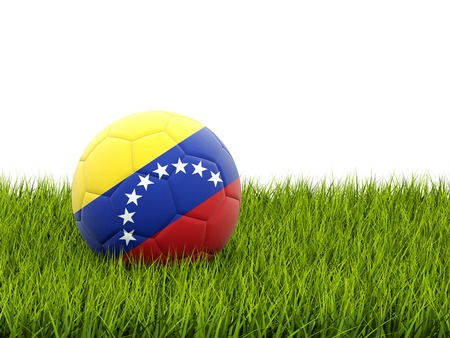 Football with flag of venezuela on green grass photo