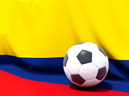 Flag of colombia with football in front of it Stock Photo
