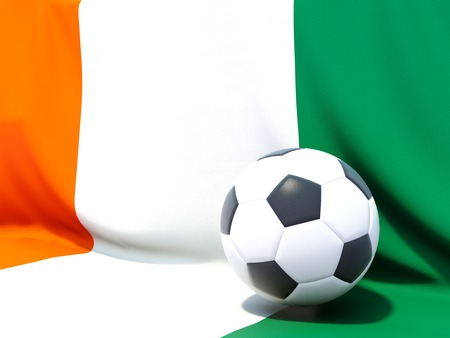 cote d'ivoire: Flag of cote d Ivoire with football in front of it