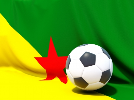 Flag of french guiana with football in front of it photo
