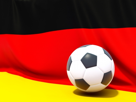 Flag of germany with football in front of it photo