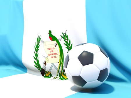 Flag of guatemala with football in front of it photo