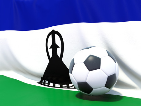 lesotho: Flag of lesotho with football in front of it