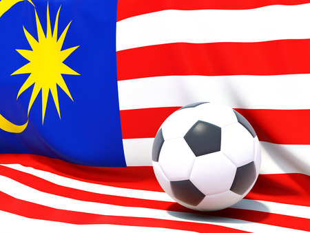 Flag of malaysia with football in front of it photo