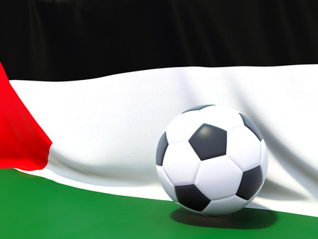 palestinian: Flag of palestinian territory with football in front of it Stock Photo