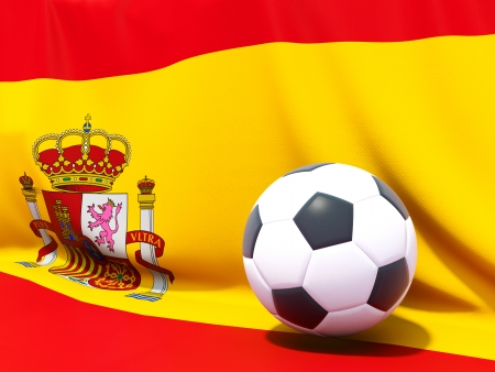 Flag of spain with football in front of it photo
