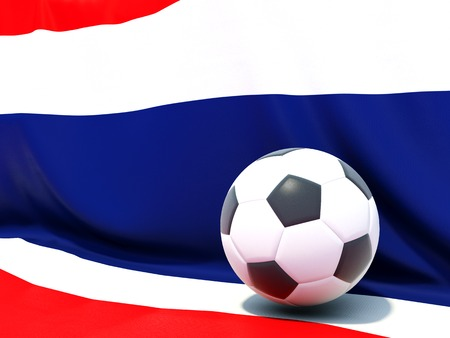 Flag of thailand with football in front of it photo