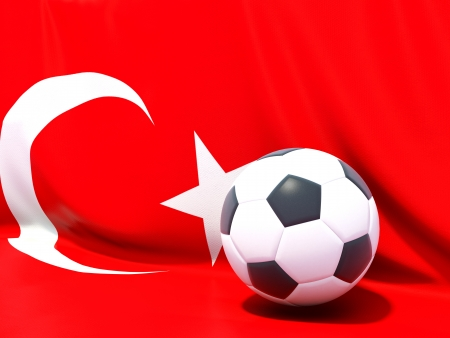 Flag of turkey with football in front of it photo