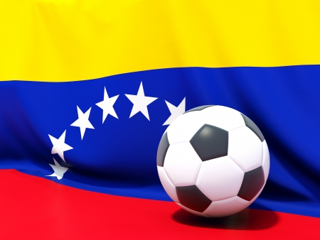 Flag of venezuela with football in front of it photo