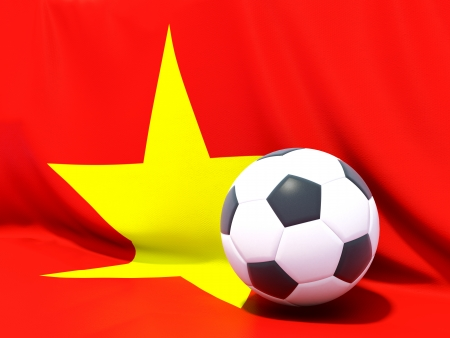 Flag of vietnam with football in front of it photo