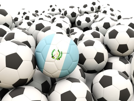 Football with flag of guatemala in front of regular balls photo