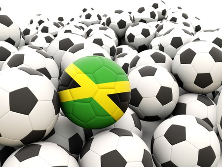 Football with flag of jamaica in front of regular balls photo