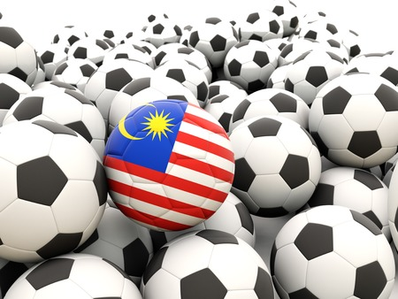 Football with flag of malaysia in front of regular balls photo