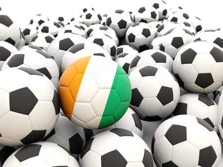Football with flag of cote d Ivoire in front of regular balls