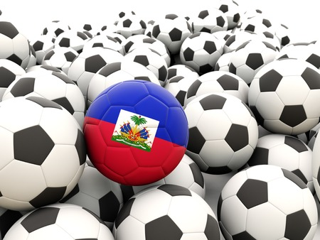 Football with flag of haiti in front of regular balls photo