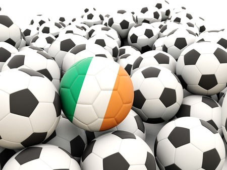 Football with flag of ireland in front of regular balls photo