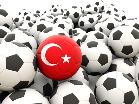 Football with flag of turkey in front of regular balls photo