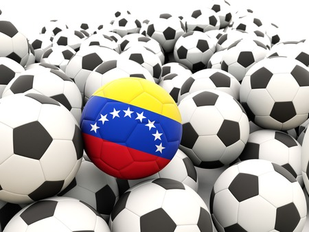 Football with flag of venezuela in front of regular balls photo