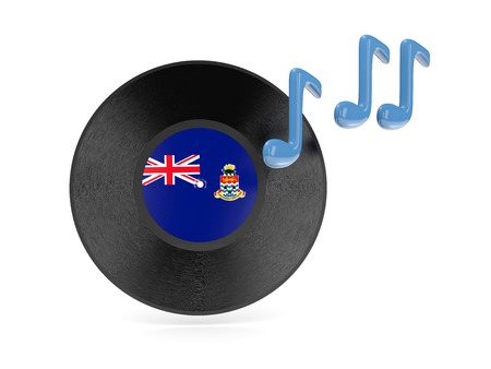 Vinyl disk with flag of cayman islands isolated on white photo
