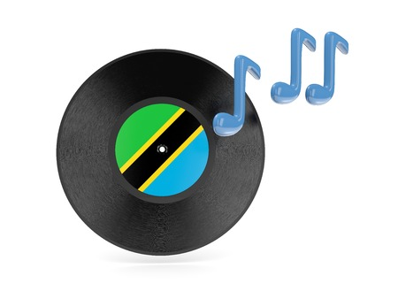 Vinyl disk with flag of tanzania isolated on white photo