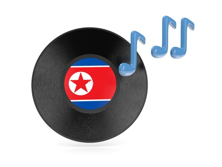 Vinyl disk with flag of north korea isolated on white photo