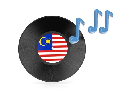 Vinyl disk with flag of malaysia isolated on white photo