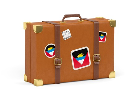 Travel suitcase with flag of antigua and barbuda isolated on white photo