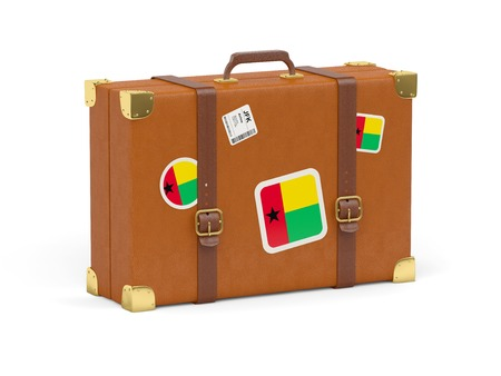guinea bissau: Travel suitcase with flag of guinea bissau isolated on white