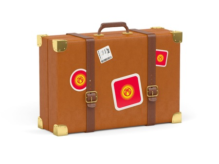 kyrgyzstan: Travel suitcase with flag of kyrgyzstan isolated on white Stock Photo