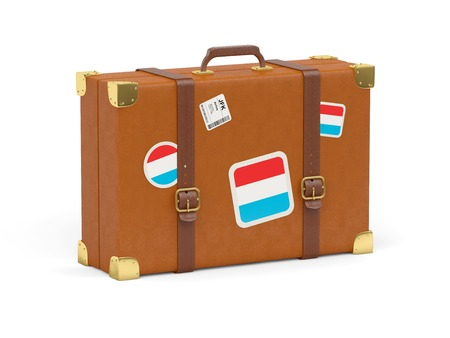 Travel suitcase with flag of luxembourg isolated on white photo