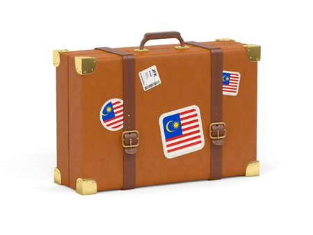 Travel suitcase with flag of malaysia isolated on white photo
