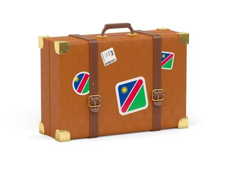 Travel suitcase with flag of namibia isolated on white photo