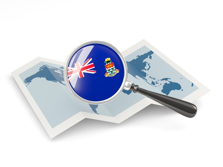 Magnified flag of cayman islands with map isolated on white photo