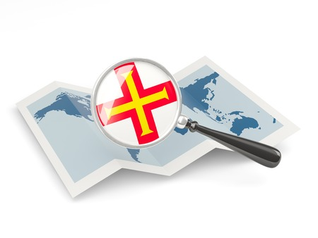 Magnified flag of guernsey with map isolated on white photo