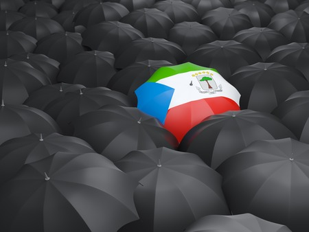 equatorial: Umbrella with flag of equatorial guinea over black umbrellas