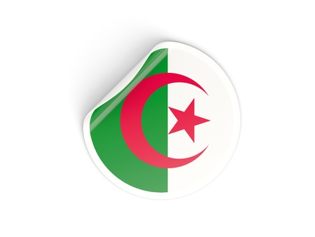 Round sticker with flag of algeria isolated on white photo