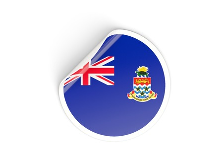 cayman islands: Round sticker with flag of cayman islands isolated on white