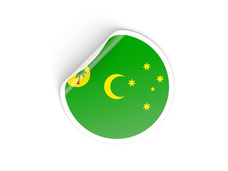 cocos: Round sticker with flag of cocos islands isolated on white