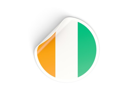 cote ivoire: Round sticker with flag of cote d Ivoire isolated on white