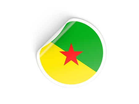 Round sticker with flag of french guiana isolated on white photo