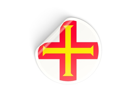 guernsey: Round sticker with flag of guernsey isolated on white Stock Photo