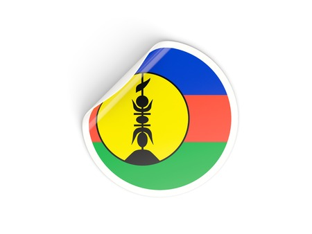 new caledonia: Round sticker with flag of new caledonia isolated on white