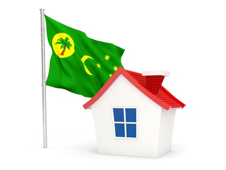cocos: House with flag of cocos islands isolated on white