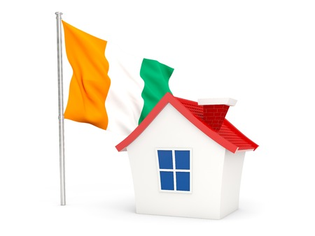 cote ivoire: House with flag of cote d Ivoire isolated on white