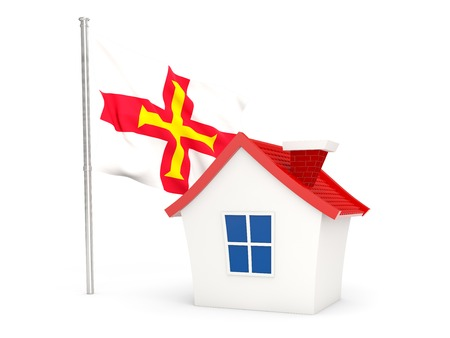 guernsey: House with flag of guernsey isolated on white