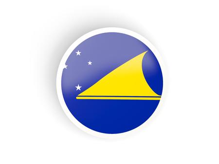 tokelau: Round sticker with flag of tokelau isolated on white